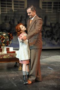 "Annie (Sophia Caruso) and ""Daddy"" Warbucks (Mark Pleasant) in Annie at Spokane Civic Theatre"